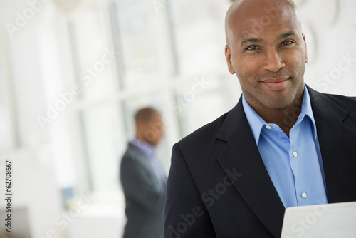Business People. A Man In A Business Suit Using A Digital Tablet.