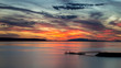 Spectacular and colorful clouds at sunset from willingdon beach in powell river, british columbia, canada.