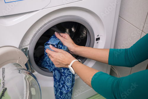 Putting a cloth into washing machine