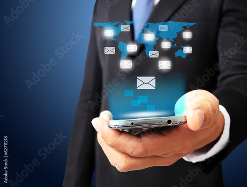 Businessman hold smart phone in hand with email social network