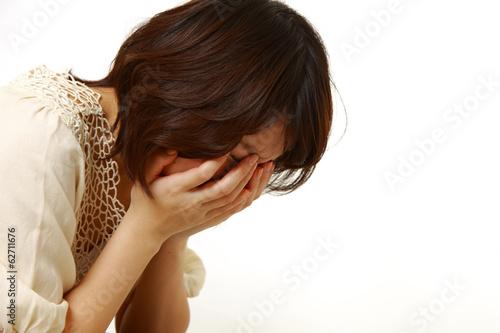 絶望する女性