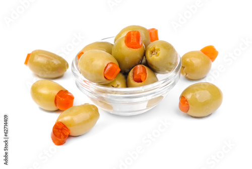 stuffed green olives in glass  isolated on white   background