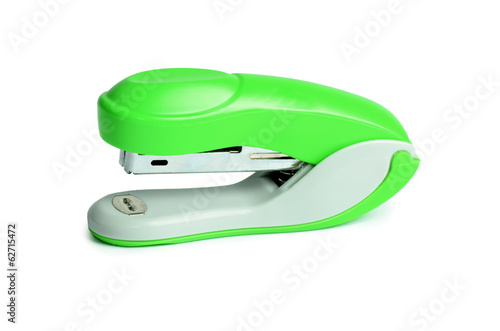 Green stapler isolated on white background