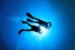 Couple Scuba Diving silhouette - 62715811