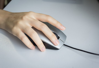 Closeup of hand using computer mouse