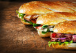 Three tasty baguettes with savory fillings - 62716092