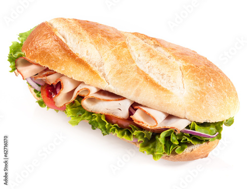 Fresh salad with chicken on a crusty baguette