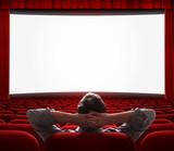 Fototapeta one man alone in empty cinema hall