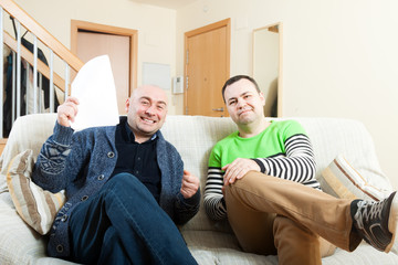 men discussing something at home