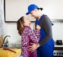 Repairman having flirt with housewife