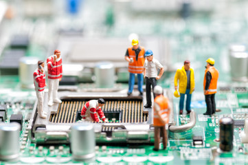 Team of engineers repairing circuit board