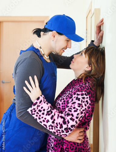 Technician having flirt with woman