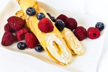 Delicious pancakes with curd and berries