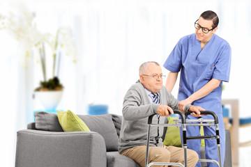Male nurse helping an elderly gentleman