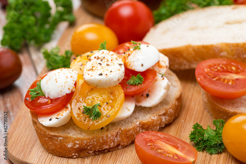 ciabatta with mozzarella and colorful cherry tomatoes