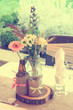 vintage table decoration with flowers and glass bottles