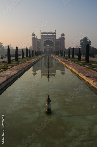 Misty Taj Mahal gateway entrance during sunrise