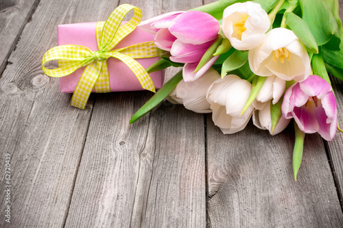 canvas print picture fresh pink  tulips with a gift box