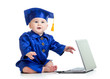 funny baby in academician clothes  with laptop