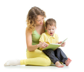 mother reading a book to her child boy