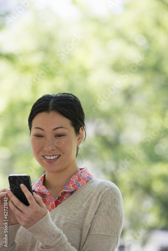 Summer. Business People. A Woman Checking Her Smart Phone For Messages.