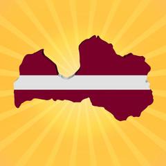 Latvia map flag on sunburst illustration