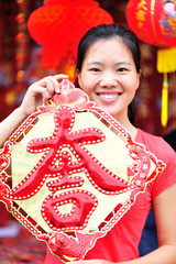 young asian woman hold a chinese daji wishing you a happy chines