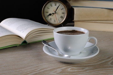 cup of coffee at a table in the library