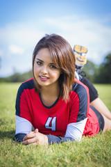USA, Texas, American High School Mädchenin Sport- Outfit