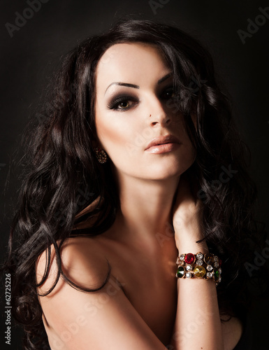 Young fasion woman with long hair and jewelry