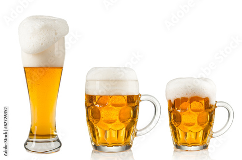 Collection of glasses of beer on white