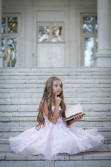 beautiful child reading a book