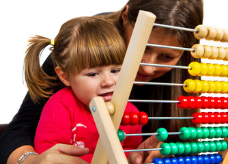 Mother and her little daughter learning math with abacus