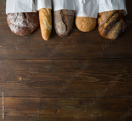 Fresh baked bread at wooden table