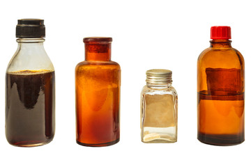 Four vintage medicine bottles isolated on white