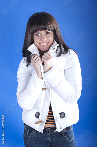 Woman in a white jacket on a blue background