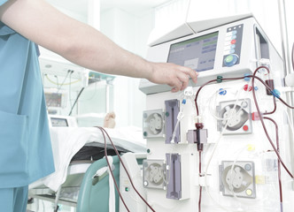 Doctor controls the process of dialysis in hospital