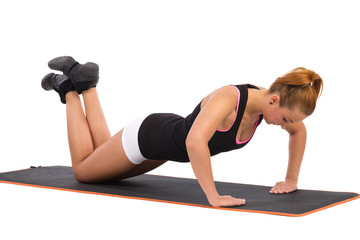 Female Push ups on Exercise Mat