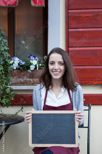 Woman chef with chalkboard