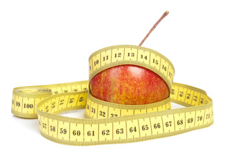 Red apple and tape measurement