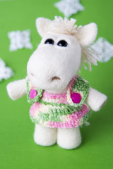 Toy white horse in a gift
