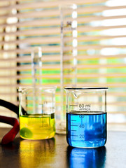 Laboratory glassware with liquid