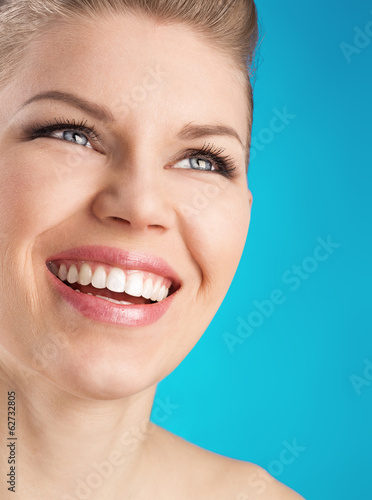 canvas print picture Perfect white toothy smile. Dental care woman.