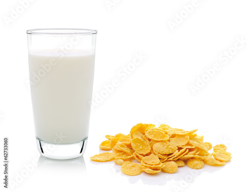 Cornflakes and milk on white background