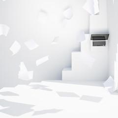 Laptop und fliegende Zettel auf weißem modernen Treppen