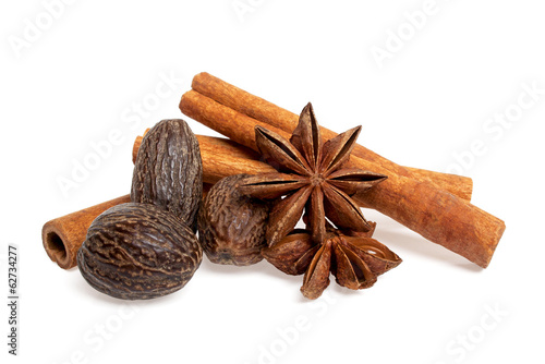Stars anise, cinnamon sticks and nutmeg isolated on white backgr