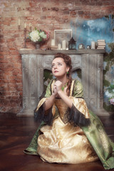 Praying beautiful woman in medieval dress
