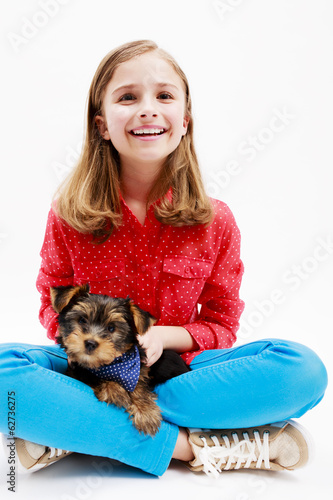 Young girl with  puppy, cute Yorkshire terrier