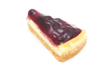 piece of blueberry cheese pie on white background