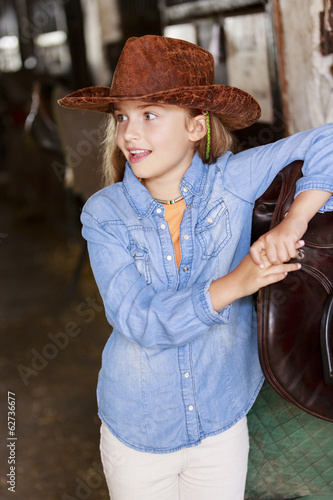 On a ranch - portrait of lovely cowgirl